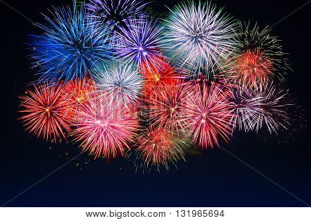 Amazing red golden blue fireworks. Celebration beautiful colorful fireworks. Holidays salute of various colors on night sky. 4 of July. 4th of July. Independence Day. New Year. Beautiful fireworks.