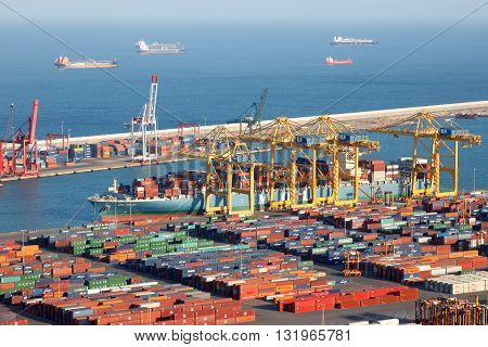 BARCELONA SPAIN - MAY 21 2016: Ship beaing loaded in the container terminal from the Port of Barcelona.