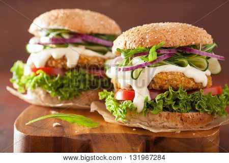 veggie carrot and oats burger with cucumber onion tomato