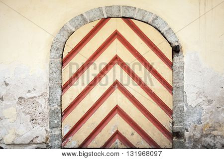 Ancient Wooden Door With Red Striped Pattern