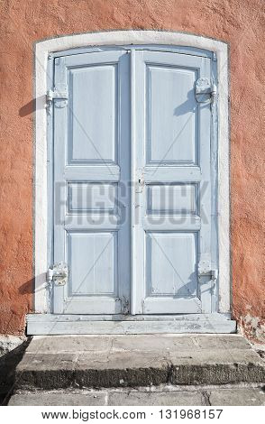 Grungy Gray Wooden Door In Old Stone Wall