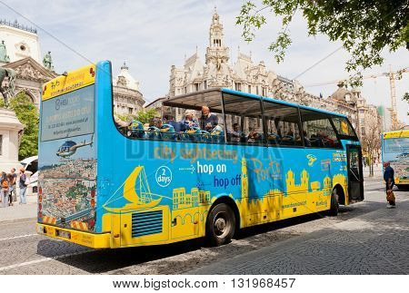PORTO PORTUGAL - MAY 26 2016: Blue Bus on Liberdade Square in the historical center of Porto Portugal (UNESCO site). Blue Bus provides city sightseeing tours around main attraction of the city