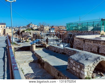 Jerusalem, Israel - February 20, 2013: Israeli People Using Roofs To Walk Across The City