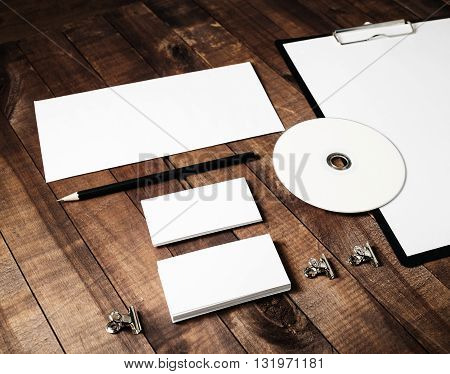 Blank stationery template on vintage wooden table background. Mock-up for branding identity. Blank template for design portfolios.