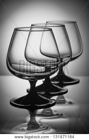 Three empty glasses in the white light