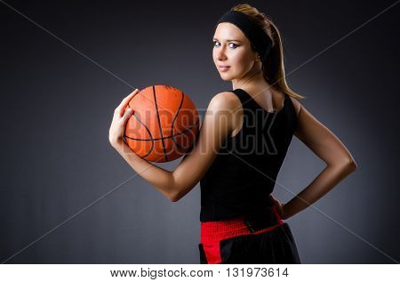 Woman with basketball in sport concept