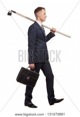 Young businessman with briefcase and rake goes doing hard work in office, isolated on the white background.