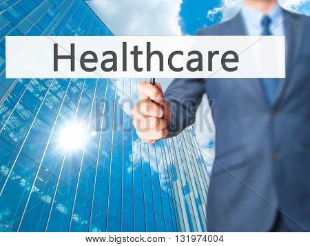Healthcare - Businessman Hand Holding Sign