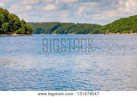 Summer landscape glassy surface of a calm river and trees