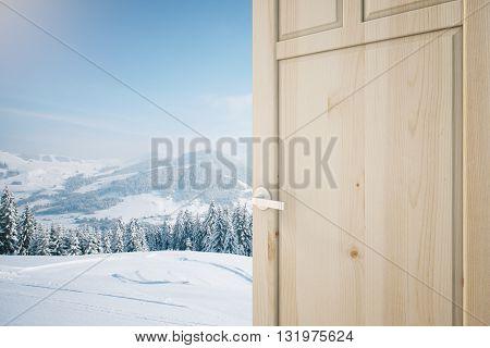 Open wooden brown door with snowy landscape view. 3D Rendering