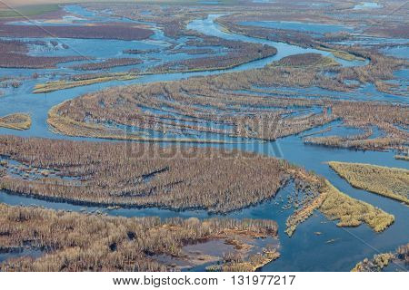 It is top view over flood-land of forest river during spring flood period.