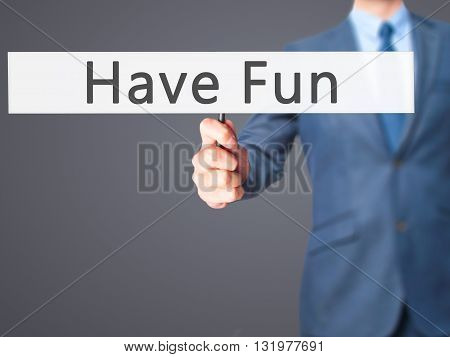 Have Fun - Businessman Hand Holding Sign