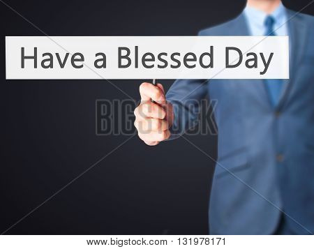 Have A Blessed Day - Businessman Hand Holding Sign