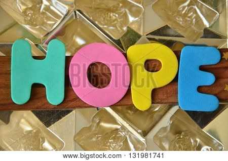 word hope on a abstract colorful t background