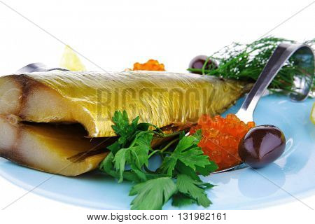 diet food - red caviar and smoked mackerel fish with lemon and dill on blue plate isolated over white background