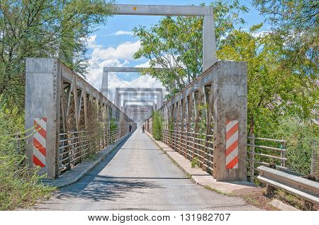 NORVALSPONT SOUTH AFRICA - MARCH 8 2016: Unidentified people on the historic road bridge over the Gariep (Orange) River at Norvalspont on the border between the Free State and Northern Cape
