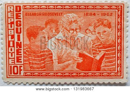 Uzhgorod, Ukraine - Circa May, 2016: Postage Stamp Printed In Guinea Republic Shows The First Lady O