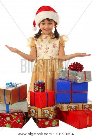 Smiling little girl with lot Christmas gift boxes