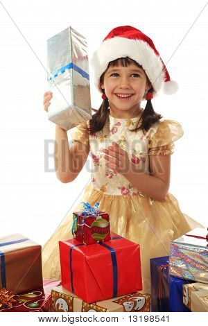 Smiling little girl with Christmas gift boxes