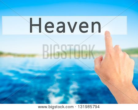Heaven - Hand Pressing A Button On Blurred Background Concept On Visual Screen.