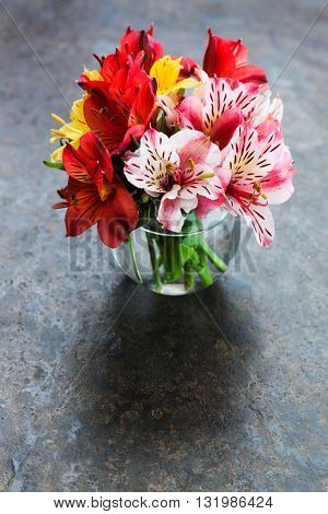 bouquet of lilies in a glass vase
