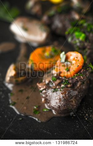 Beef bourguignon and sauce on the black stone vertical