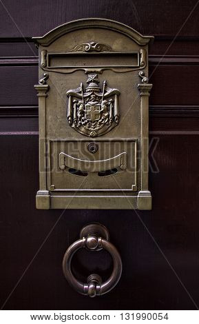 Italian metal mailbox with coat of arms and door handle