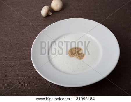 White mushroom cream soup on a table