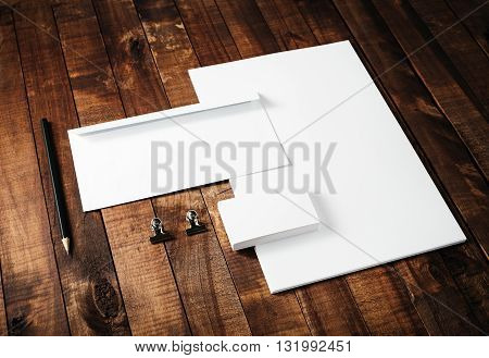 Blank corporate identity template on vintage wooden table background. Blank stationery mock-up. For design portfolios.