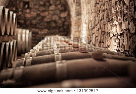 Abstract blurry background of wine cellar .