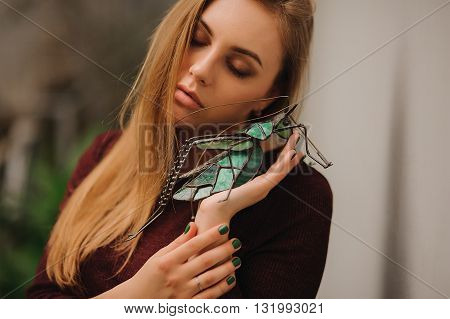 sensual portrait of blond woman with closed eyes
