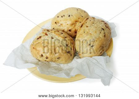Three Bun wheat on a paper napkin isolated on white