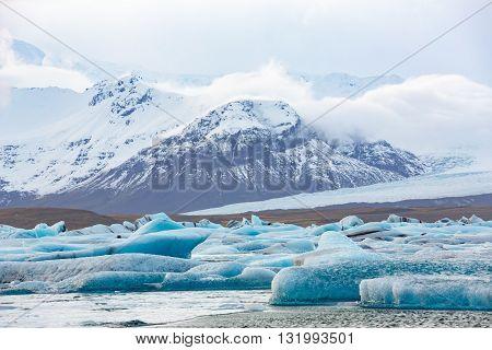 The glacial lagoon Jokulsarlon with mountains view, Iceland