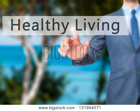 Healthy Living - Businessman Hand Pressing Button On Touch Screen Interface.