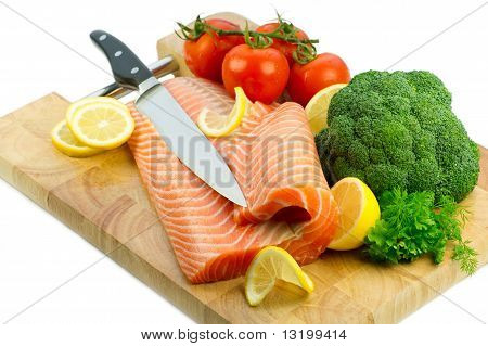 Isolated Fresh Raw Red Fish With Vegetables, Lemon