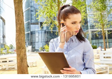Businesswoman with  headset and tablet