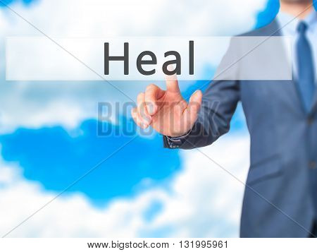 Heal - Businessman Hand Pressing Button On Touch Screen Interface.