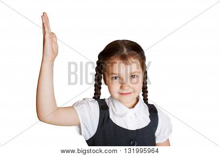 Elementary school child raising her hand up. Isolated on white background