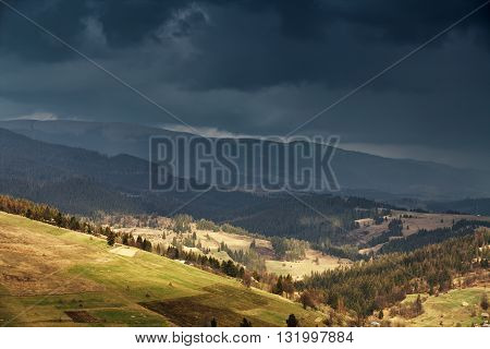Spring Rain In Mountains. Thunder And Clouds