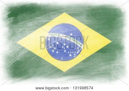 Brazilian flag on plain background
