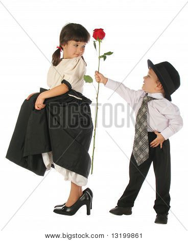 Little boy and girl with red rose