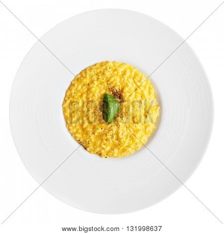 Risotto with saffron and chocolate isolated on white background