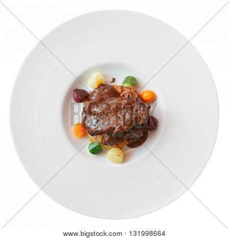 Meat with pepper sauce shot from above, isolated on white background