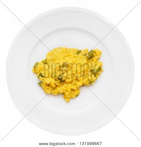 Risotto with saffron and asparagus isolated on white background