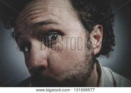 Fear, man with intense expression, white shirt