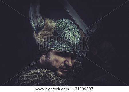 Human, Costume, Viking warrior with a huge sword and helmet with horns
