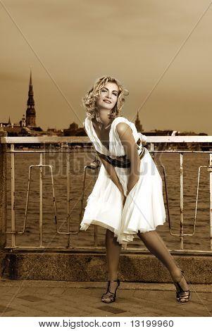 Beautiful retro stylized photo of a pretty woman that looks like Marilyn Monroe