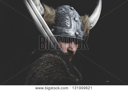 Evil, Viking warrior with iron sword and helmet with horns