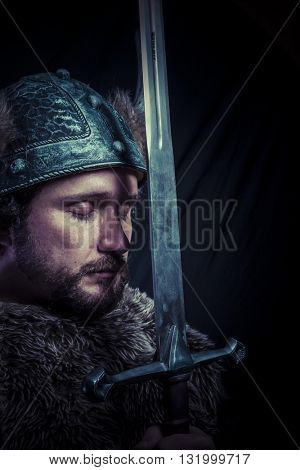War, Viking warrior with iron sword and helmet with horns