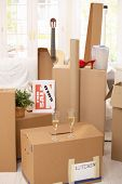 stock photo of boxing day  - Pile of boxes in new house - JPG